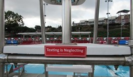 Texting is Neglecting on Lifeguard Stand